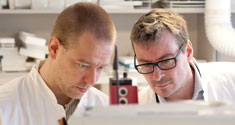 Willerslev and Rasmussen in the laboratory.