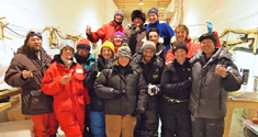 Researchers celebrates in one of the ice trenches.
