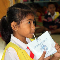 Girl from Thailand drinking fluorized milk